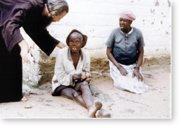 John with two Mutemwa residents
